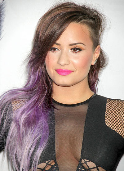 The many hairstyles of demi lovato la live still half shaved head with a brown to purple ombre urmus Images